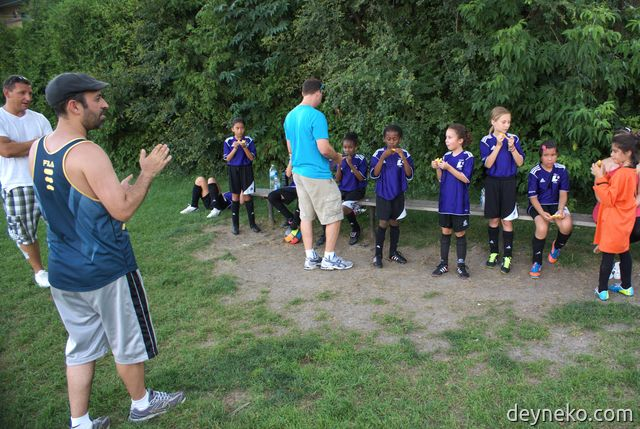 Kids from soccer team eating sweets