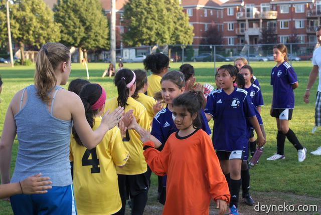"girls soccer teams say ""good game"" to each other"